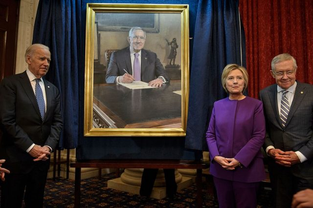 Vice President Joe R. Biden (L), Hillary Clinton (C) and Senate Minority Leader Senator Harry Reid (D-NV) pose with a portrait of the outgoing minority leader during a ceremony on Capitol Hill December 8, 2016 in Washington, D.C. (BRENDAN SMIALOWSKI/AFP/Getty Images)
