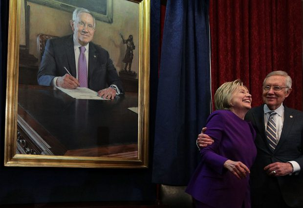 Harry Reid hugs Hillary Clinton during his leadership portrait unveiling ceremony on December 8, 2016 at the U.S. Capitol (Getty Images)