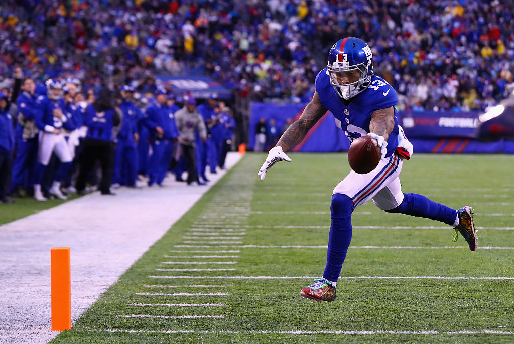Odell Beckham Jr. #13 of the New York Giants makes a catch to carry the ball 4-yards for a touchdown against the Detroit Lions in the fourth quarter at MetLife Stadium on December 18, 2016 in East Rutherford, New Jersey. (Photo by Al Bello/Getty Images)