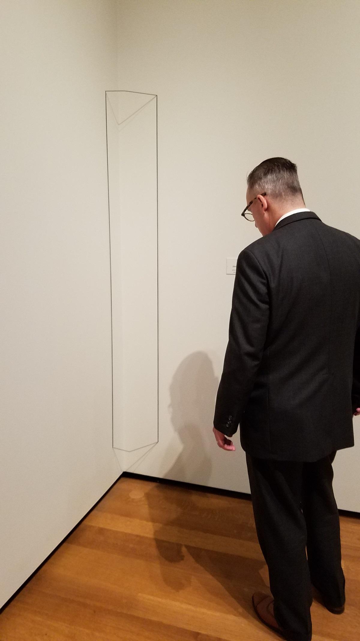 "Fred Sandback's ""Untitled (gray corner construction)."""
