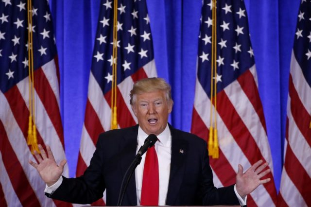 FILE PHOTO: U.S. President-elect Donald Trump speaks during a news conference in the lobby of Trump Tower in Manhattan, New York City, U.S., January 11, 2017. REUTERS/Lucas Jackson/File Photo