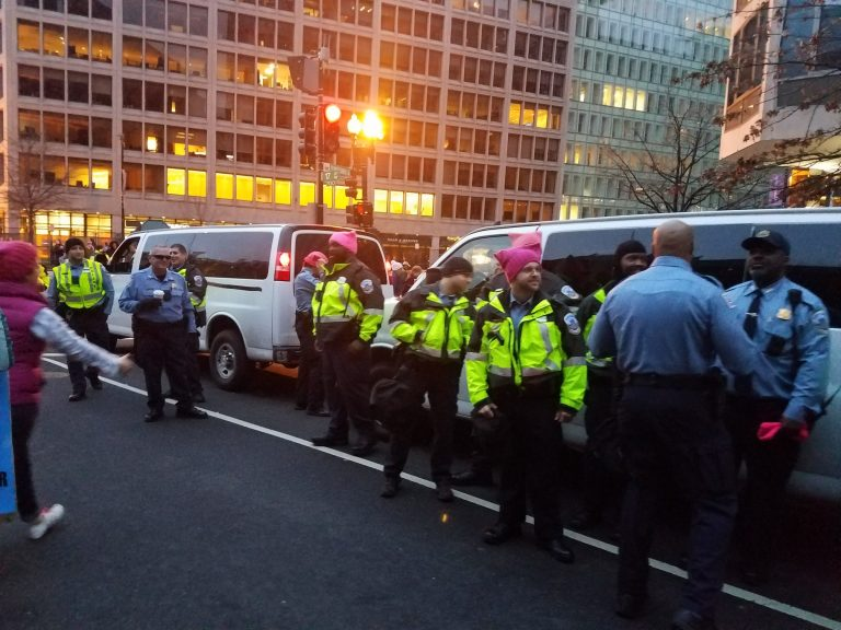 Several officers pose in front of police van Phillip Stucky