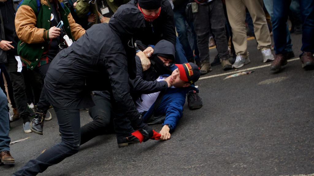 A protester chokes a Trump supporter as they attempt to steal his - Daily Caller - Grae Stafford
