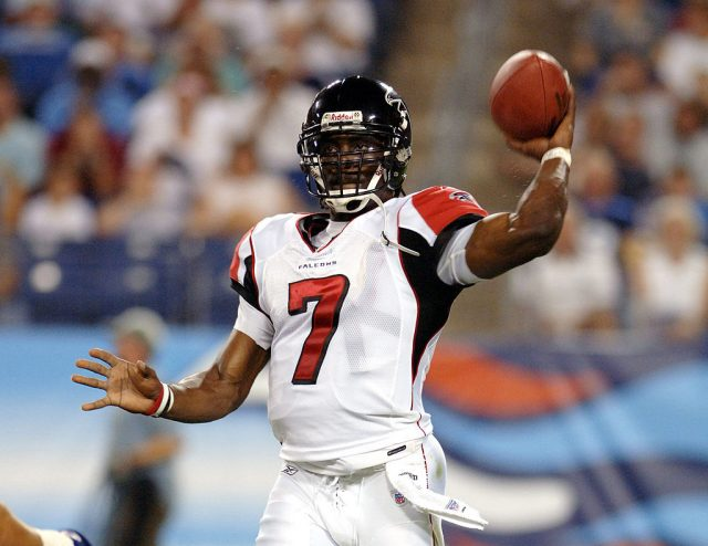 Falcons Michael Vick #7 throws during first half action between the Atlanta Falcons and the Tennessee Titans on August 26, 2006 at The Coliseum in Nashville, Tennessee. (Photo by Joe Murphy/NFLPhotoLibrary/Getty Images)