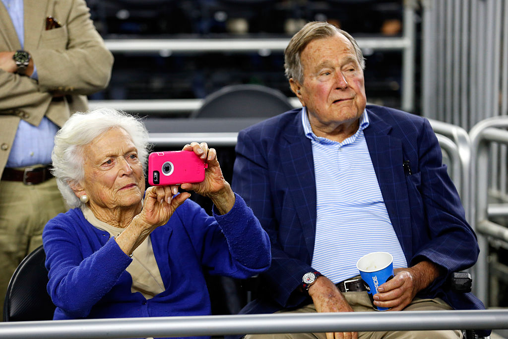 Former First Lady Barbara Bush and former President George H.W. Bush look on prior to the South Regional Final of the 2015 NCAA Men's Basketball Tournament between the Duke Blue Devils and the Gonzaga Bulldogs at NRG Stadium on March 29, 2015 in Houston, Texas. (Photo by Tom Pennington/Getty Images)