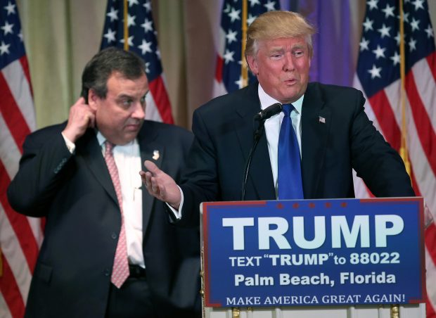 PALM BEACH, FL - MARCH 01: New Jersey Governor Chris Christie accompanies Republican Presidential frontrunner Donald Trump on the stage at a press conference on March 1, 2016 in Palm Beach, Florida. Christie stood by, often distracted, as Trump held a press conference at his Mar a Lago Club after the polls closed on Super Tuesday. (Photo by John Moore/Getty Images)