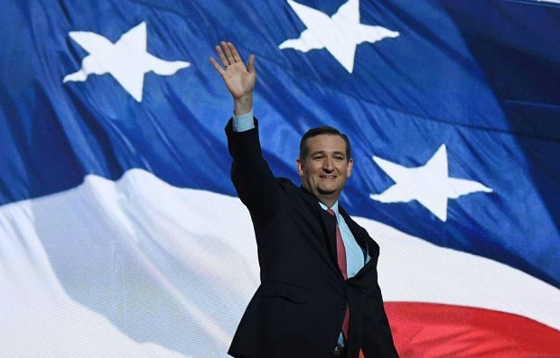 Sen. Ted Cruz waves as he arrives on stage at the Republican National Convention at the Quicken Loans Arena in Cleveland, Ohio on July 20, 2016. (Photo credit: JIM WATSON/AFP/Getty Images)
