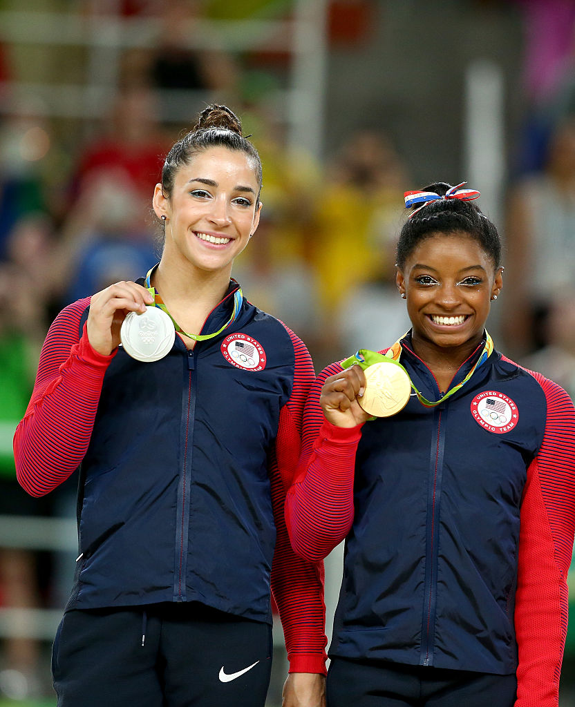 Silver medalist Alexandra Raisman (L) and gold medalist Simone Biles (R) of the United States pose for photographs on the podium at the medal ceremony for the Women's Floor on Day 11 of the Rio 2016 Olympic Games at the Rio Olympic Arena on August 16, 2016 in Rio de Janeiro, Brazil. (Photo by Alex Livesey/Getty Images)