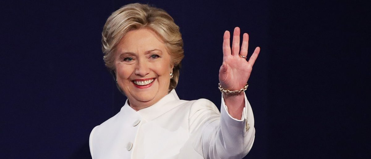 Democratic presidential nominee former Secretary of State Hillary Clinton waves to the crowd as she walks on the stage during the third U.S. presidential debate at the Thomas & Mack Center on October 19, 2016 in Las Vegas, Nevada. (Drew Angerer/Getty Images)