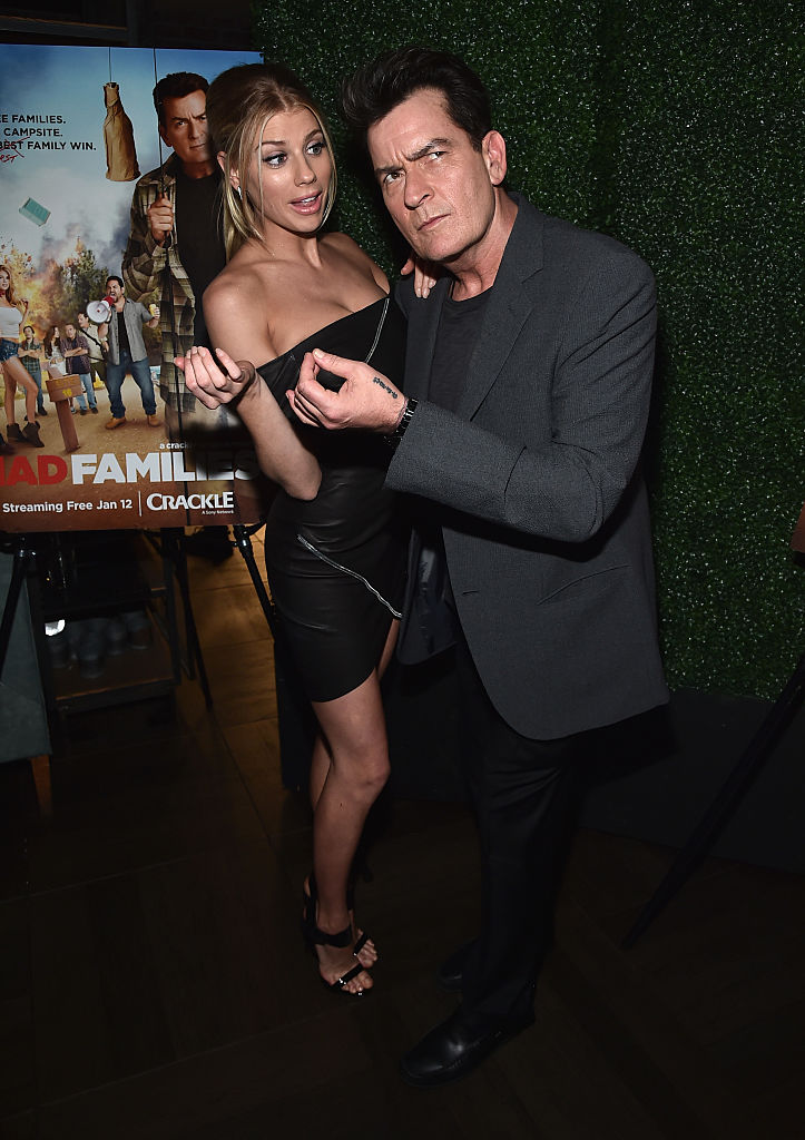 """Actors Charlotte McKinney and Charlie Sheen attend the premiere party for Crackle's """"Mad Families"""" at Catch on January 9, 2017 in West Hollywood, California. (Photo by Alberto E. Rodriguez/Getty Images)"""