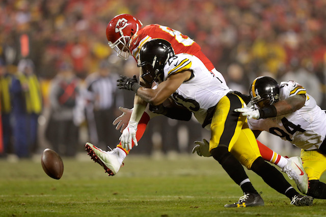 KANSAS CITY, MP - JANUARY 15: Free safety Mike Mitchell #23 of the Pittsburgh Steelers breaks up a pass catch attempt from tight end Travis Kelce #87 of the Kansas City Chiefs during the second half in the AFC Divisional Playoff game at Arrowhead Stadium on January 15, 2017 in Kansas City, Missouri. (Photo by Jamie Squire/Getty Images)