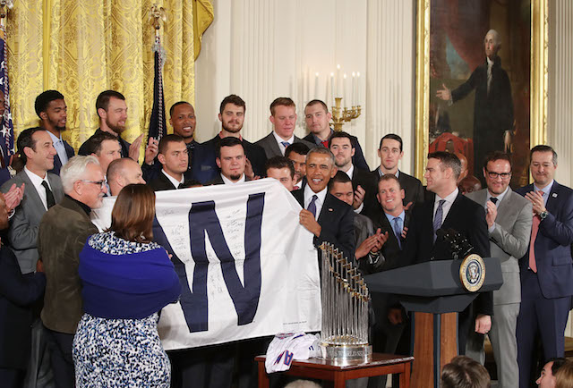 WASHINGTON, DC - JANUARY 16: President Barack Obama shows a W flag given to him by the 2016 World Series Champion Chicago Cubs in The East Room at the White House, on January 16, 2017 in Washington, DC. The Cubs beat the Cleveland Indians in last year's World Series ending a 108-year drought. (Photo by Mark Wilson/Getty Images)