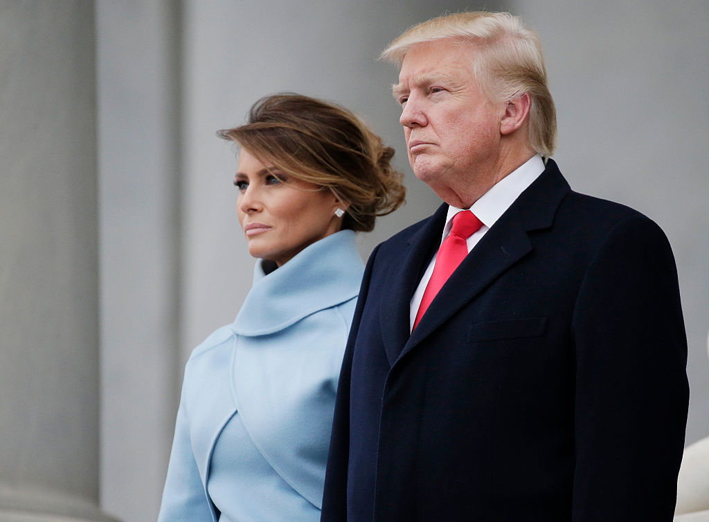 President Donald Trump stands with First Lady Melania Trump back to the Capitol Building before departing for the parade after Trump is sworn in at the 58th Presidential Inauguration on Capitol Hill in Washington, D.C. on January 20, 2017. (Photo by John Angelillo-Pool/Getty Images)