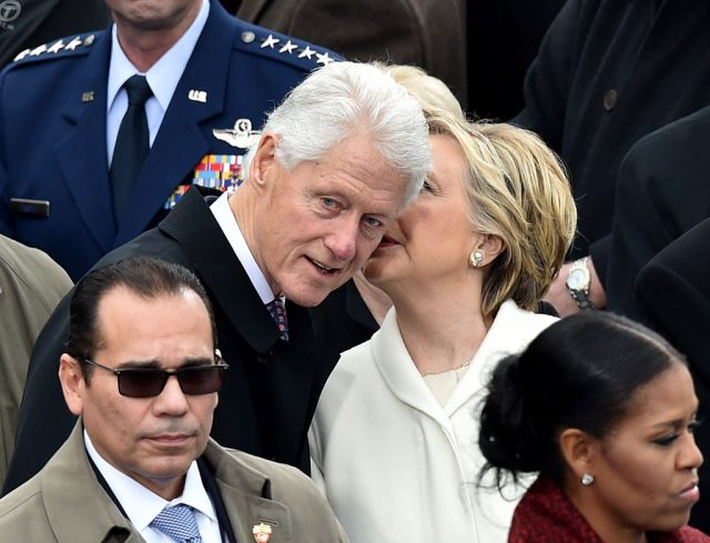Former President Bill Clinton and Hillary Clinton on the platform before the swearing in ceremony for Donald Trump at the U.S. Capitol January 20, 2017 in Washington, D.C. (Photo credit: PAUL J. RICHARDS/AFP/Getty Images)
