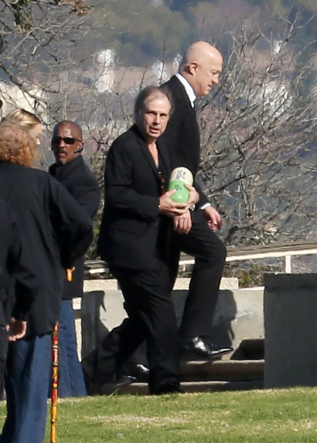 Todd Fisher carries his sisters urn (Photo credit: Splash News)