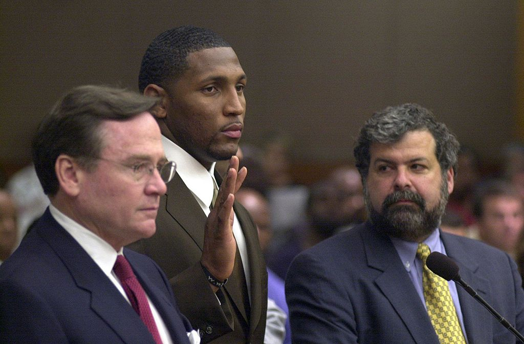 Defense attorney Ed Garland (L), Baltimore Ravens football player Ray Lewis (C), and defense attorney Don Samuel (R) stand as Lewis pleads guilty to the charge of misdemeanor obstruction of justice after striking a plea bargain with the district attorney's office for the lower charge in exchange for his testimony against the other two co-defendants for the Buckhead double homicide last January. Lewis was in Fulton Superior Court making his plea to Judge Alice Bonner 05 June 2000 in Atlanta. (Photo credit should read KIMBERLY SMITH/AFP/Getty Images)