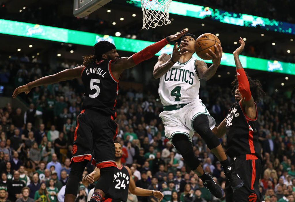 Isaiah Thomas #4 of the Boston Celtics takes a shot against DeMarre Carroll #5 of the Toronto Raptors and Lucas Nogueira #92 during the fourth quarter at TD Garden on February 1, 2017 in Boston, Massachusetts. The Celtics defeat the Raptors 107-102. (Photo by Maddie Meyer/Getty Images)