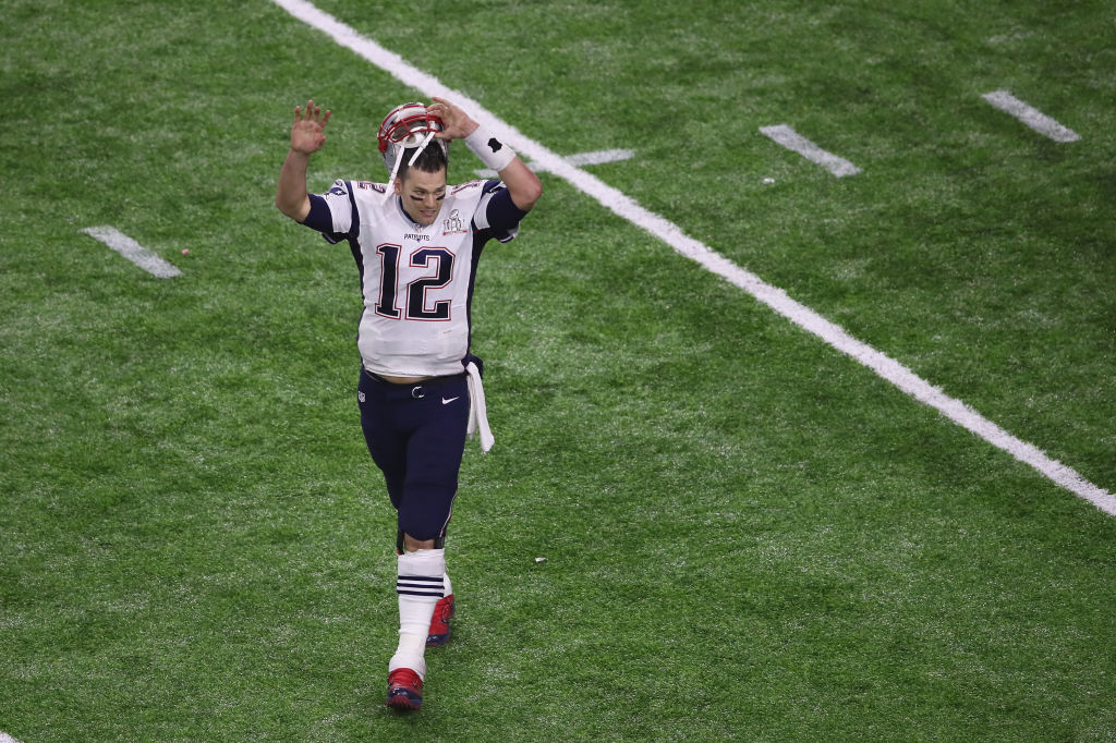 Tom Brady #12 of the New England Patriots celebrates after defeating the Falcons 34-28 during Super Bowl 51 at NRG Stadium on February 5, 2017 in Houston, Texas. (Photo by Ezra Shaw/Getty Images)