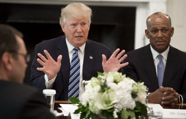 President Donald Trump speaks during a meeting with airline industry executives, including Myron Gray (R), President of US Operations at UPS, in the State Dining Room of the White House in Washington, D.C., February 9, 2017. (Photo credit: SAUL LOEB/AFP/Getty Images)