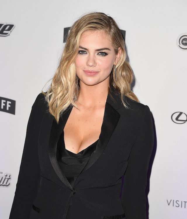Kate Upton rocked a black suit at the launch party (Photo credit should read ANGELA WEISS/AFP/Getty Images)
