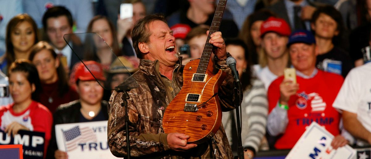 Musician and political activist Ted Nugent performs for the audience during a campaign rally for U.S. Republican presidential nominee Donald Trump at the Devos Place in Grand Rapids, Michigan November 7, 2016. REUTERS/Rebecca Cook