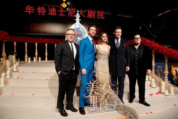 "Director Bill Condon and actors Dan Stevens, Emma Watson, Luke Evans, and Josh Gad (L-R) pose for photographers on the red carpet for the film ""Beauty and the Beast"" in Shanghai, China February 27, 2017. REUTERS/Aly Song"
