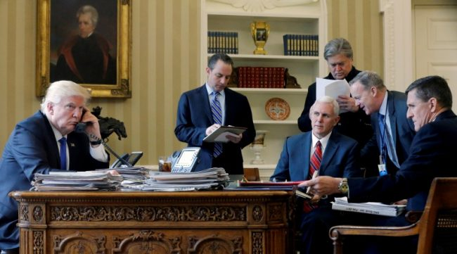 FILE PHOTO: President Donald Trump, joined by Chief of Staff Reince Priebus, Vice President Mike Pence, senior advisor Steve Bannon, press secretary Sean Spicer and then National Security Advisor Michael Flynn, speaks by phone with Russia's President Vladimir Putin in the Oval Office at the White House in Washington, January 28, 2017. REUTERS/Jonathan Ernst/File Photo