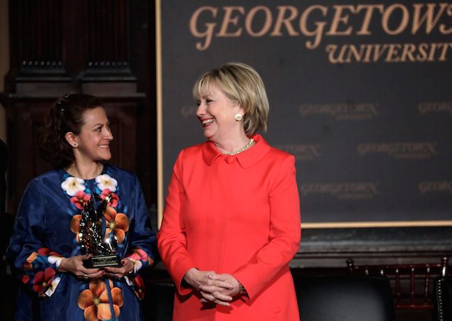 Former secretary of state Hillary Clinton looks toward awardee Jineth Bedoya, a Colombian journalist and advocate for victims of sexual violence, during an ceremony honoring women and their role in international politics and peace building efforts hosted by the Georgetown Institute for Women, Peace and Security in Washington, March 31, 2017. REUTERS/Kevin Lamarque