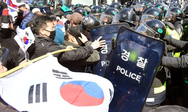 Protesters supporting South Korean President Park Geun-hye clash with riot policemen near the Constitutional Court in Seoul, South Korea, in this photo taken by Kyodo on March 10, 2017. Mandatory credit Kyodo/via REUTERS