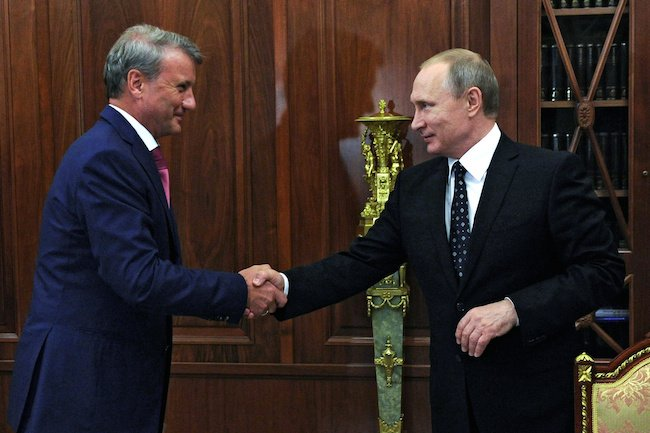 Russian President Vladimir Putin shakes hands with Sberbank's Chief Executive Officer Herman Gref during a meeting at the Kremlin in Moscow, Russia, August 4, 2016. Sputnik/Kremlin/Mikhail Klimentyev/via REUTERS