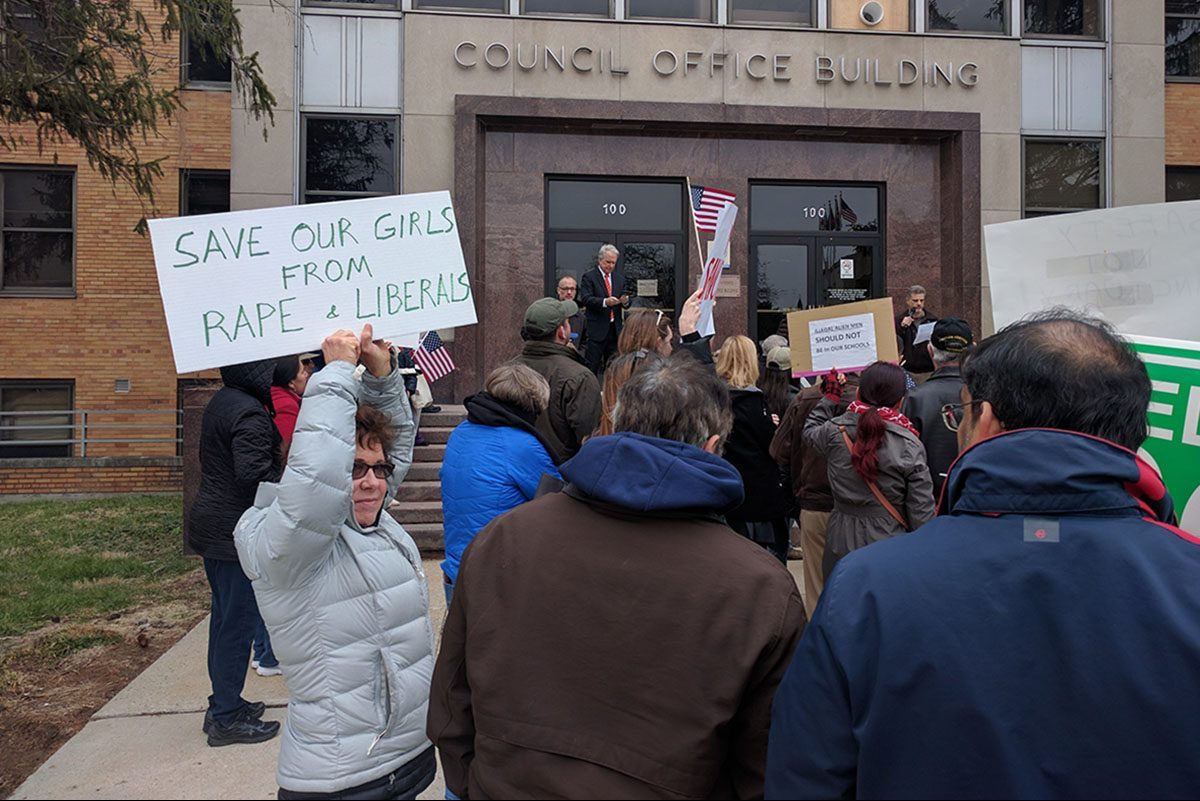 Protesters voice their concerns over sanctuary policies at a rally outside the Montgomery County Council Building on March 26, 2017.