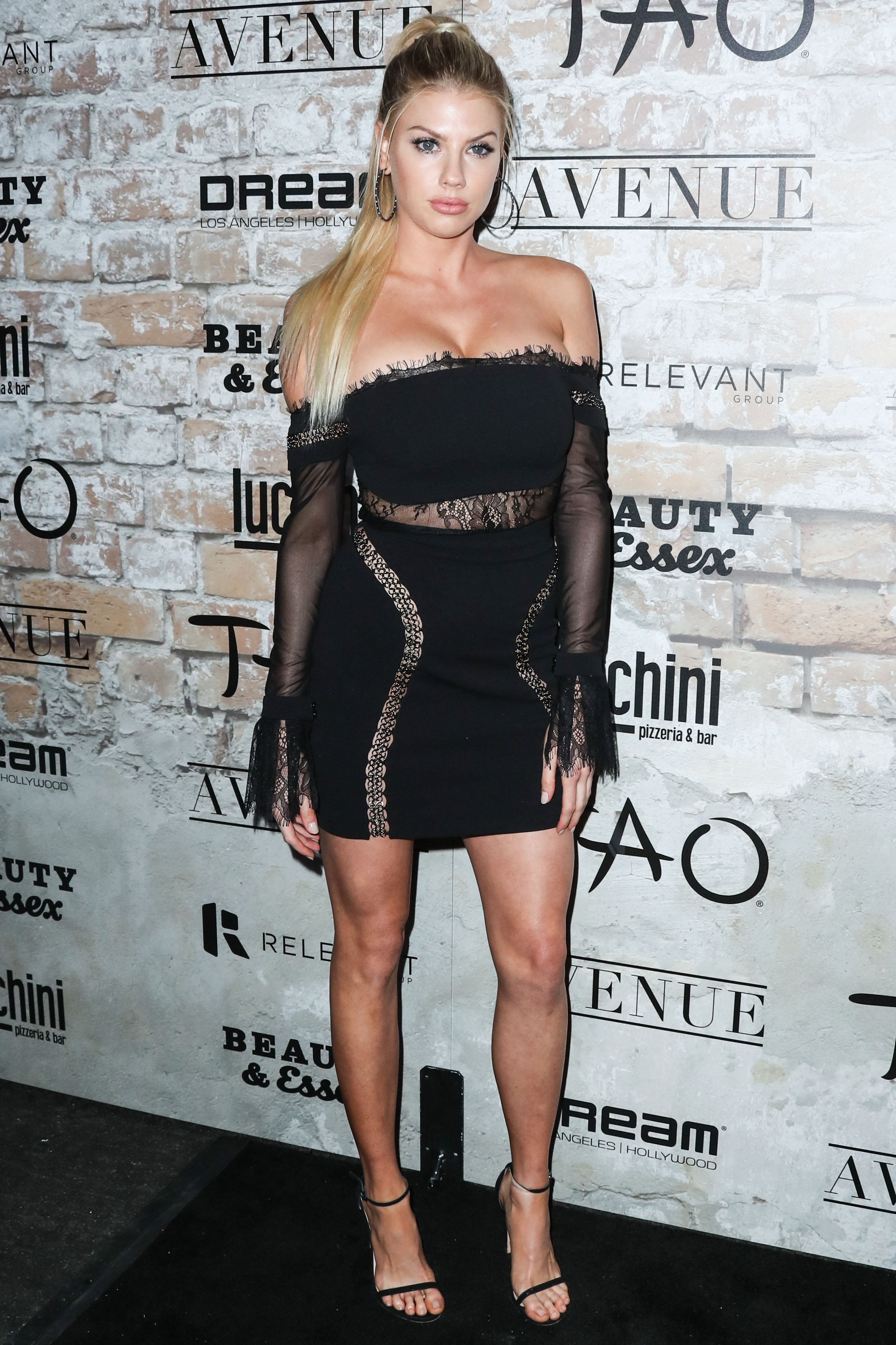 Charlotte McKinney Stays Warm While Wearing Nothing But A
