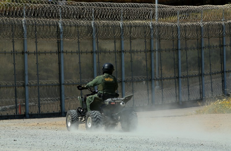 A U.S. border patrol agent patrols the U.S. and Mexico border fence in San Ysidro, California, U.S. April 18, 2017. REUTERS/Mike Blake