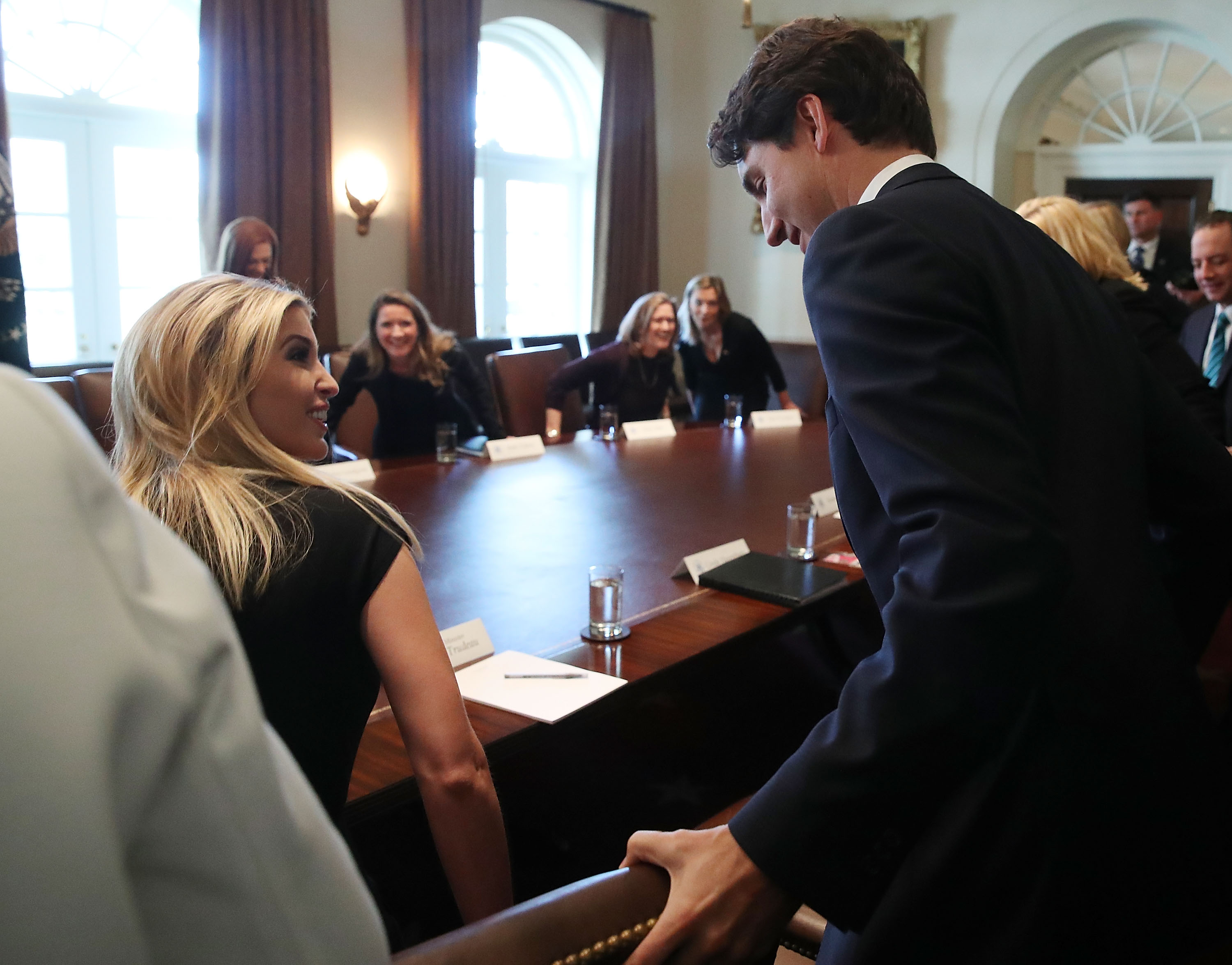 WASHINGTON, DC - FEBRUARY 13: Canadian Prime Minister Justin Trudeau (R) helps Ivanka Trump with he chair during a roundtable discussion on the advancement of women entrepreneurs and business leaders at the White House February 13, 2017 in Washington, DC. Later in the day Prime Minister Justin Trudeau will joing U.S. President Donald Trump in a joint news conference. (Photo by Mark Wilson/Getty Images)
