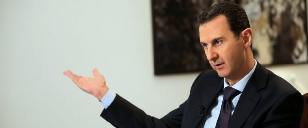Syrian President Bashar al-Assad gestures during an exclusive interview with AFP in the capital Damascus on February 11, 2016. Joseph Eid/AFP/Getty Images.