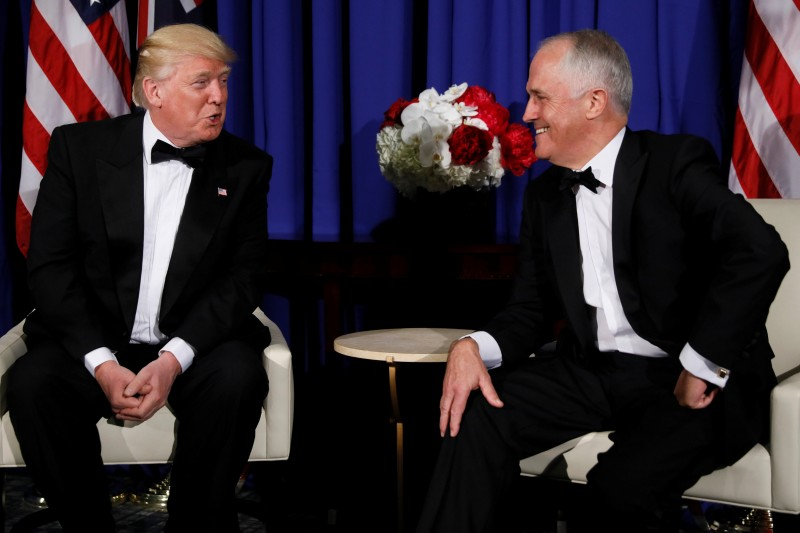 U.S. President Donald Trump (L) and Australia's Prime Minister Malcolm Turnbull (R) deliver brief remarks to reporters as they meet ahead of an event commemorating the 75th anniversary of the Battle of the Coral Sea, aboard the USS Intrepid Sea, Air and Space Museum in New York, U.S. May 4, 2017. REUTERS/Jonathan Ernst