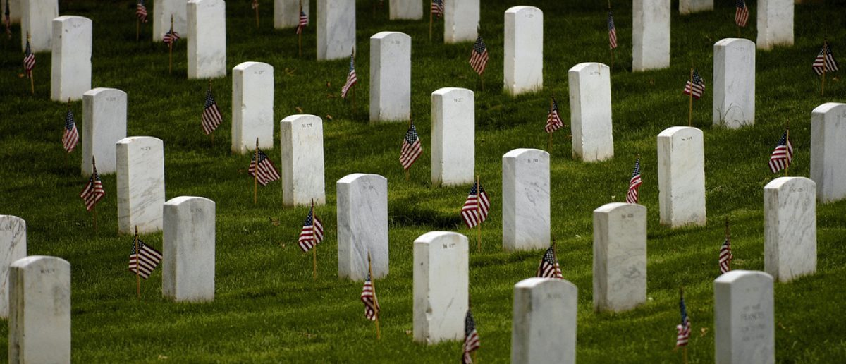 (Arlington National Cemetery - May 22, 2008) -- Flags stand vigil at gravesites in Arlington National Cemetary. The 3rd U.S. Infantry Regiment (The Old Guard) began their rounds to place a small American flag into the ground in front of every grave marker at Arlington National Cemetery for the upcoming Memorial Day observance. (Photo by Adam Skoczylas).