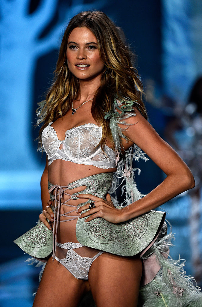 Behati Prinsloo strikes a pose at the end of the runway. (Photo by Pascal Le Segretain/Getty Images)
