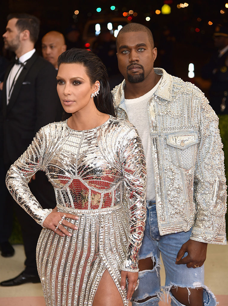 """NEW YORK, NY - MAY 02: Kim Kardashian (L) and Kanye West attend the """"Manus x Machina: Fashion In An Age Of Technology"""" Costume Institute Gala at Metropolitan Museum of Art on May 2, 2016 in New York City. (Photo by Dimitrios Kambouris/Getty Images)"""