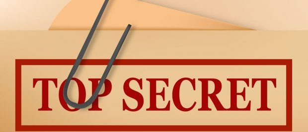 Top secret folder file with slight grunge. Vector. (Shutterstock/ecco)