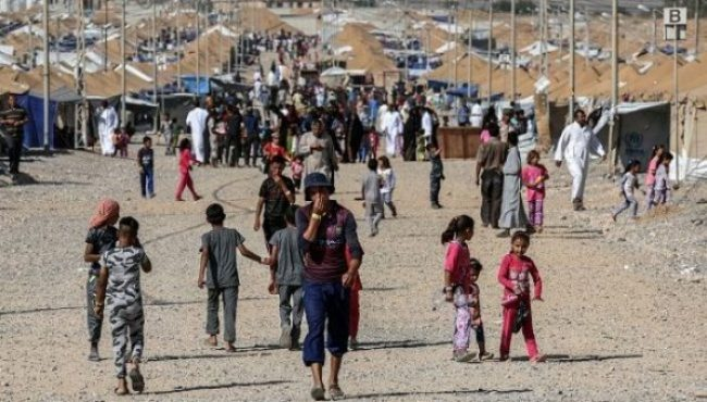 Nearly half of Mosul's population has fled the city to escape the violence. Thousands more civilians perished in the eight month conflict. (MOHAMED EL-SHAHED/AFP/Getty Images)