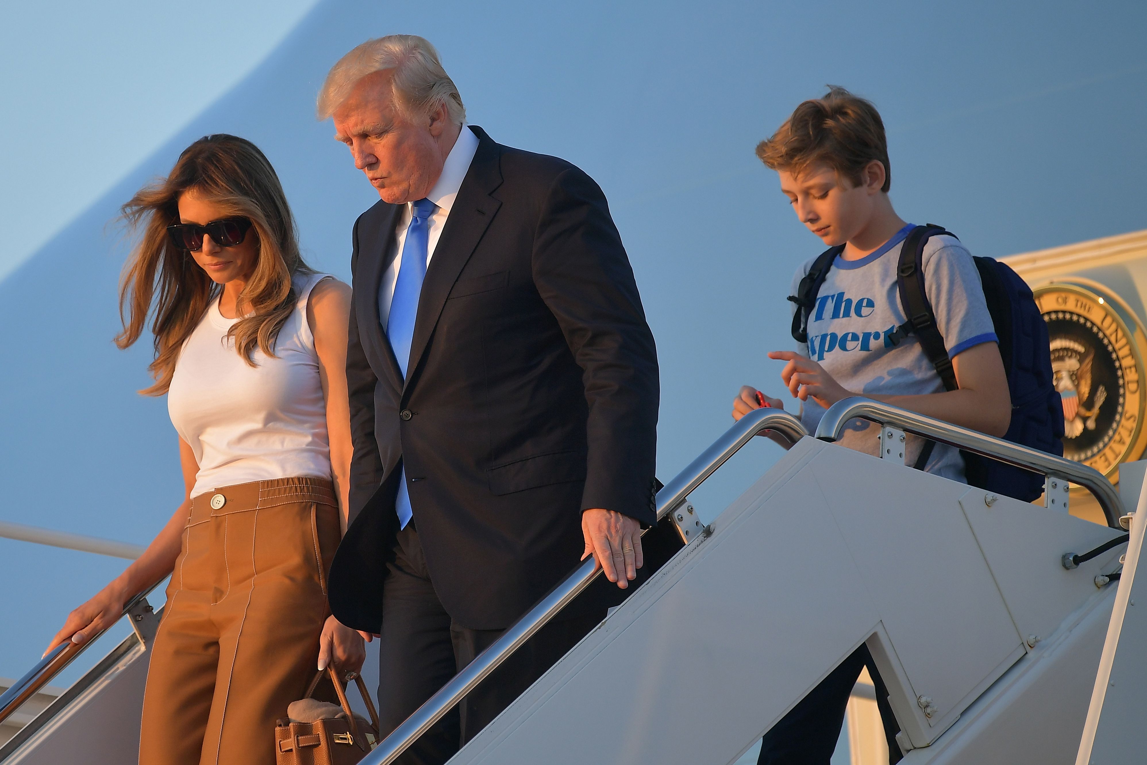 US President Donald Trump (C), first lady Melania Trump, and their son Barron Trump walk off Air Force One after arriving at Andrews Airforce base, Maryland on June 11 2017. Trump is returning to Washington, DC after spending the weekend at this Bedminster, New Jersey golf club. MANDEL NGAN/AFP/Getty Images