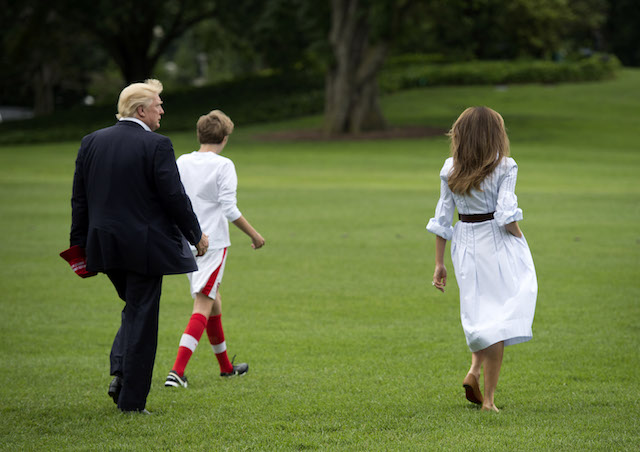 WASHINGTON, DC - JUNE 17: (AFP OUT) U.S. President Donald J. Trump boards Marine One with first lady Melania Trump and their son Barron Trump, as they depart the White House for Camp David, June 17, 2017 in Washington, DC. (Photo by Molly Riley -Pool/Getty Images