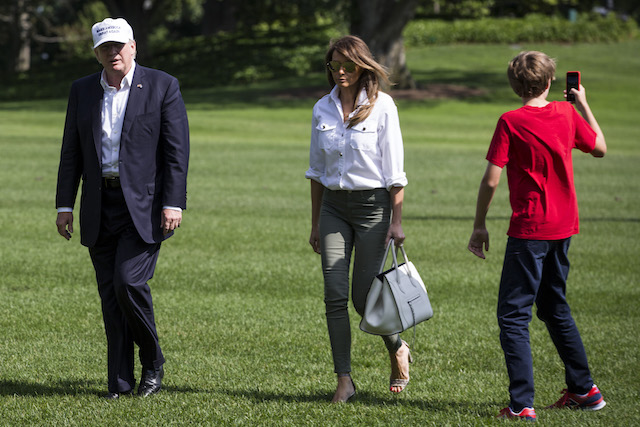 WASHINGTON, DC - JUNE 18: President Donald Trump, First Lady Melania Trump and their son, Barron Trump, cross the South Lawn after arriving at The White House on June 18, 2017 in Washington, D.C. President Trump spent the weekend at Camp David. (Photo by Zach Gibson/Getty Images)