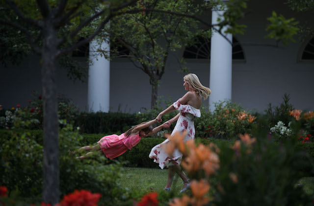 WASHINGTON, DC - JUNE 22: Ivanka Trump (R), daughter and assistant to President Donald Trump, plays with her daughter Arabella Rose Kushner (L) in the Rose Garden during during a Congressional Picnic on the South Lawn of the White House June 22, 2017 in Washington, DC. President Trump and the first lady hosted their first Congressional Picnic with the theme, Picnic in the Park, which is Òmodeled after a summer evening in Central Park in New York.ÓÊ (Photo by Alex Wong/Getty Images)