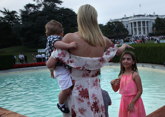 WASHINGTON, DC - JUNE 22: Ivanka Trump (L), daughter and assistant to President Donald Trump, shares a moment with her daughter Arabella Rose Kushner (R) during during a Congressional Picnic on the South Lawn of the White House June 22, 2017 in Washington, DC. President Trump and the first lady hosted their first Congressional Picnic with the theme, Picnic in the Park, which is modeled after a summer evening in Central Park in New York (Photo by Alex Wong/Getty Images)