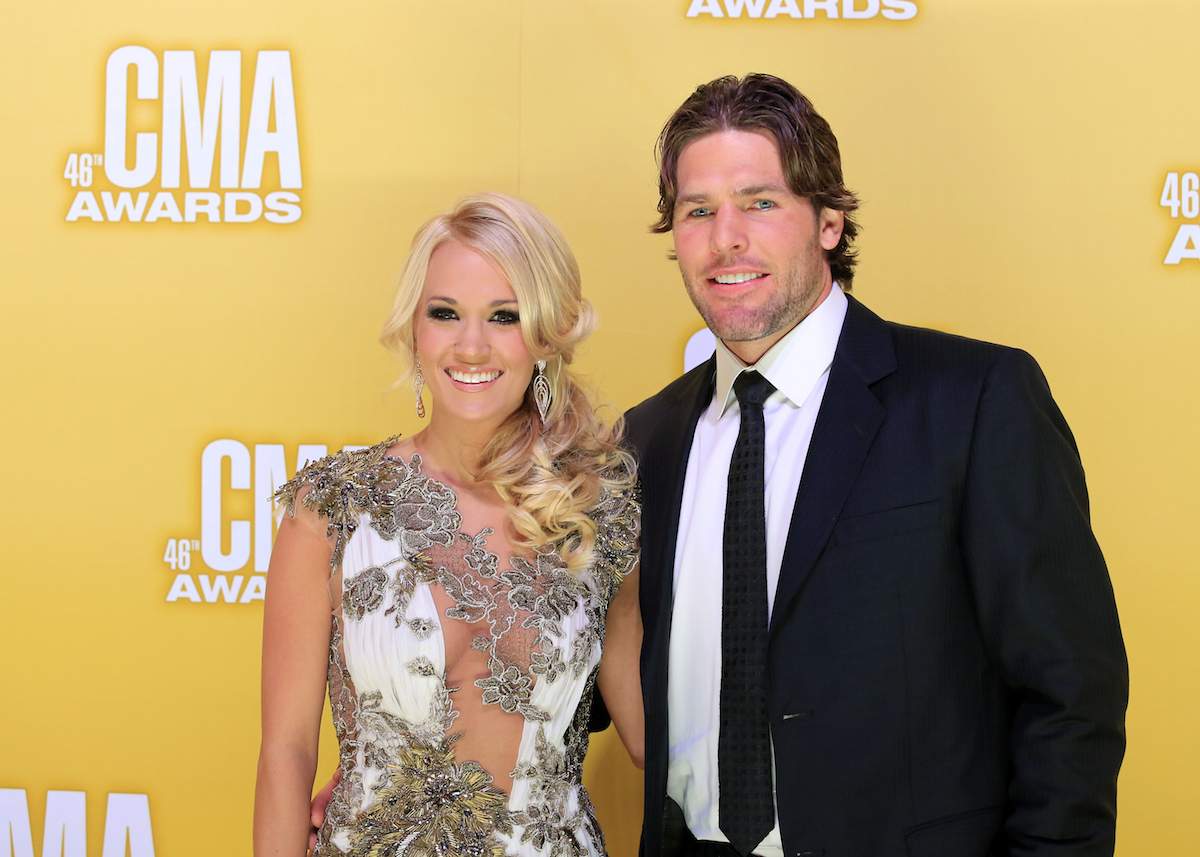 During her fifth year hosting, Carrie Underwood posed with her husband, NHL hockey player Mike Fisher, at the 46th Country Music Association Awards. (Photo: Reuters)
