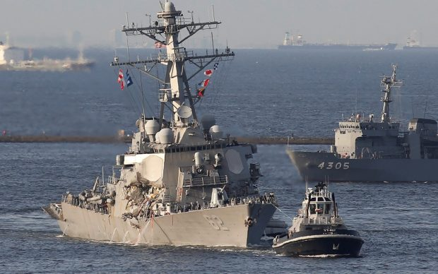 The Arleigh Burke-class guided-missile destroyer USS Fitzgerald, damaged by colliding with a Philippine-flagged merchant vessel, is towed by a tugboat upon its arrival at the U.S. naval base in Yokosuka, south of Tokyo, Japan June 17, 2017. REUTERS/Toru Hanai