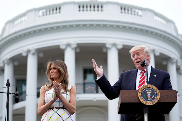 U.S. President Donald Trump delivers remarks as he hosts a Congressional picnic event, accompanied by First Lady Melania Trump, at the White House in Washington, U.S., June 22, 2017. REUTERS/Carlos Barria TPX IMAGES OF THE DAY - RTS18A89