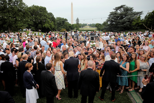 U.S. President Donald Trump and First Lady Melania Trump greet members of the congress and their families as they host a congressional picnic event at the White House in Washington, U.S., June 22, 2017. REUTERS/Carlos Barria - RTS18A9G